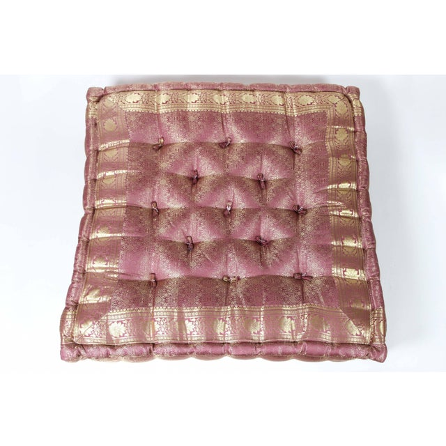 Oversized silk square mauve and gold tufted floor pillow. Handcrafted from silk sari fabric, these floor seat cushions are...