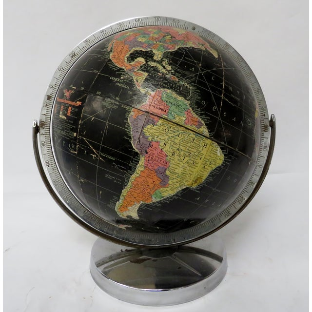 """Vintage 12"""" Replogle globe in black on chrome stand and support. Cartographer, Gustav Brueckmann. Good condition with..."""