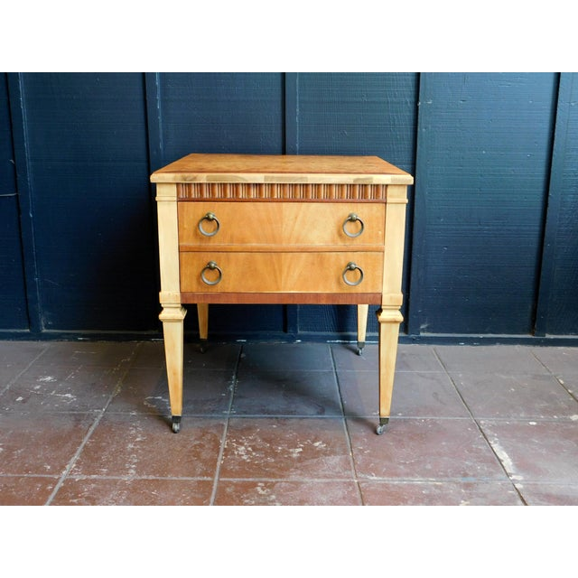 These sweet vintage end tables feature a classic details. A nice honey finish brings these bag to life.