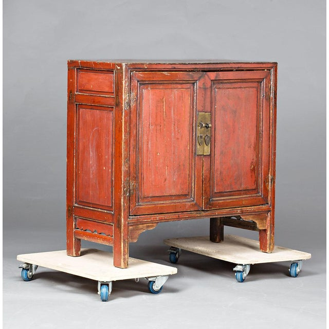 Chinese cabinet in red-lacquered wood from Ningbo, first half of the 20th Century.