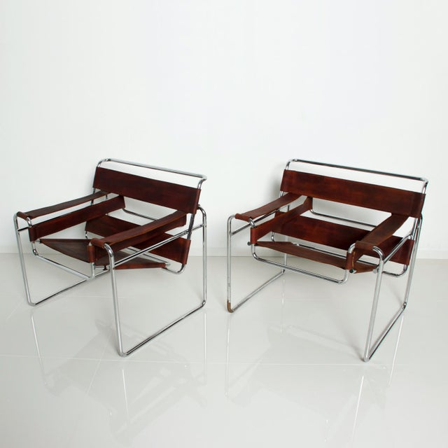For your consideration a pair of Wassily chairs designed by MArcer Breuer for Gavina, Italy circa 1980s. Original chrome-...