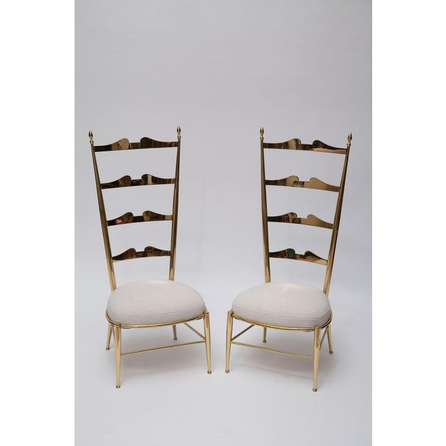 """These fantastical and rare Italian brass Chiavari chairs have tall exaggerated backs and very low seats on truncated 9""""..."""