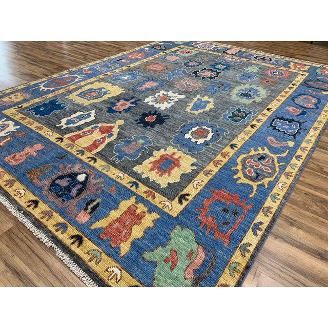 The warm colors of this beautiful modern oushak are both fun and eye-catching. It's lovely new design will add personality...