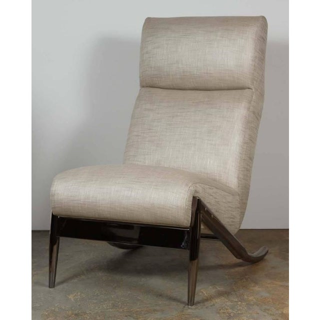 Paul Marra Slipper Chair in unlacqured polished black nickel shown with linen upholstery. COM only - COM quantity is 5yds....
