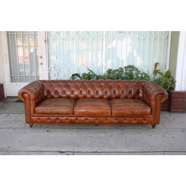 Vintage distressed leather tufted sofa in excellent condition, Sofa is very comfortable and clean.. No rips or damages on...