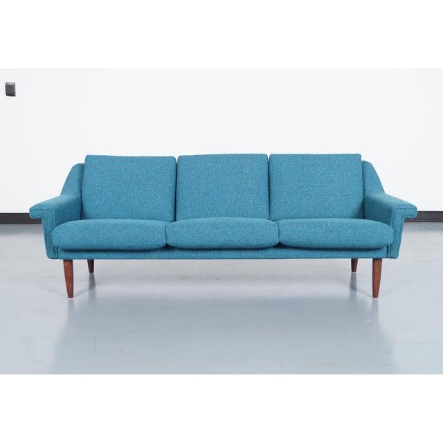 Danish modern sofa attributed to Hans Wegner. Cushion contain original coil springs for superior comfort.