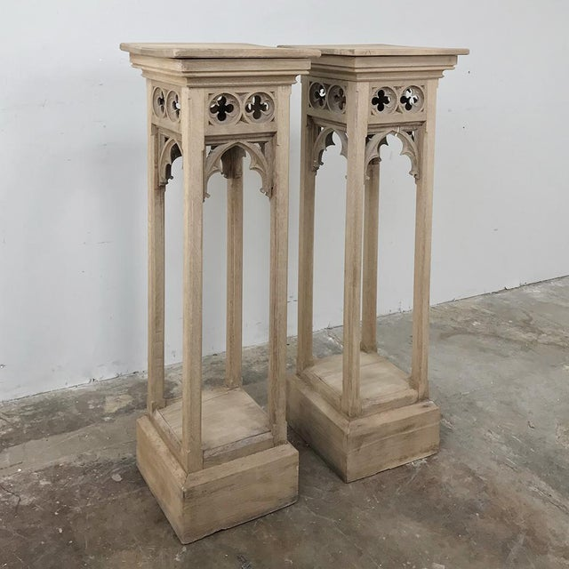 Pair 19th Century Gothic Stripped Oak Pedestals are ideal for displaying your matched pair or coordinating objets d'art!...