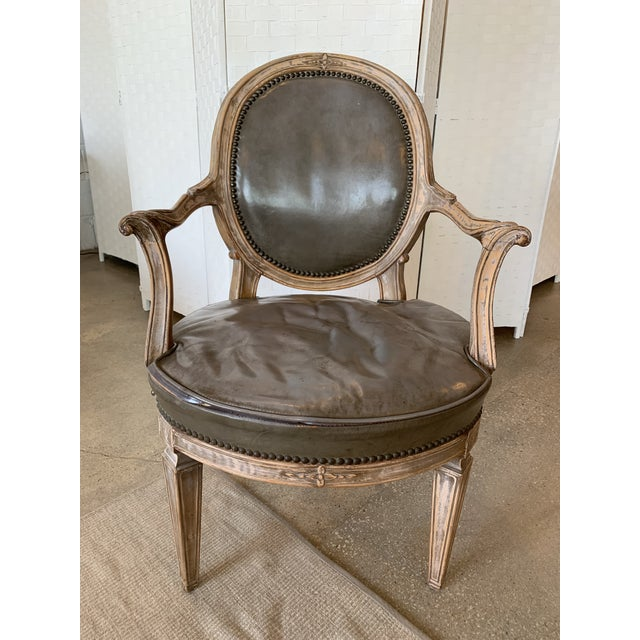 Rare set of eight Handsome Don Rousseau Louis XVI-Style Leather Upholstered Carved Beechwood Fauteuils with medallion oval...