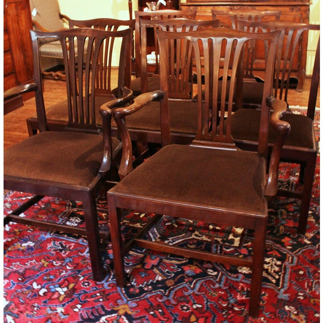 A set of 8 dining chairs, Chippendale style, late 19th-early 20th Century. Mahogany. English. Well shaped, carved...