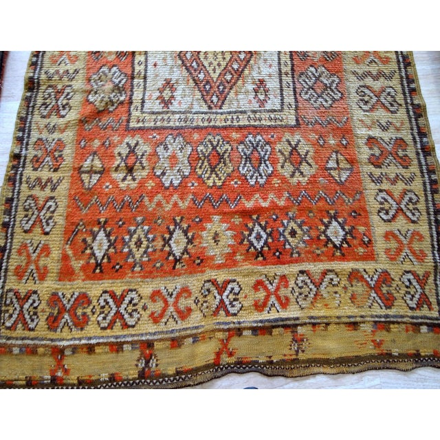 Antique Moroccan Berber rug in original condition ( has some age wear). The rug is in red and yellow shades, from the...