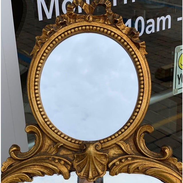 """Narrow """"trumeau"""" mirror in Louis XV style. Wood and gesso frame has many fine details including a ribbon along the top,..."""
