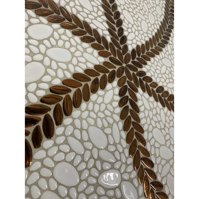Gorgeous Probber style Mid-Century white mosaic ceramic tile top coffee table with bronze pinwheel design. Tapered metal...
