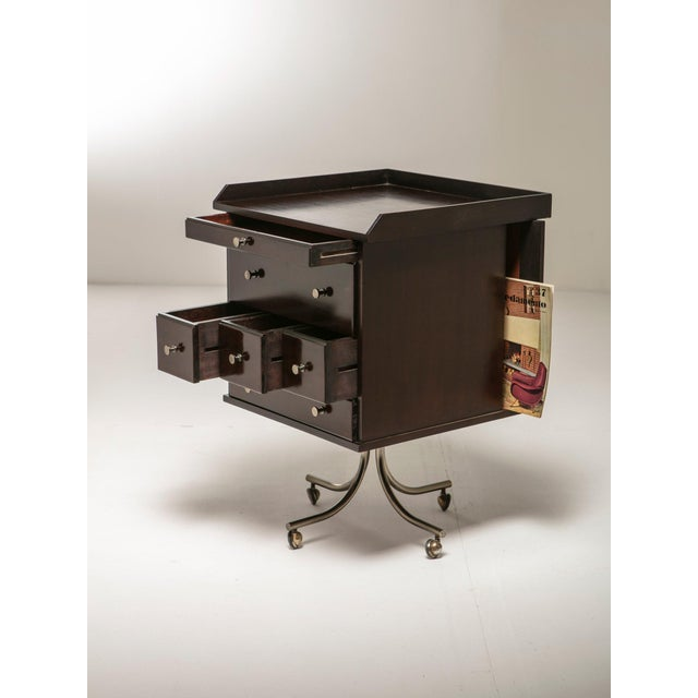 Remarkable wood cabinet on wheels with several drawers and opens. Detailed with nickel plated hand grips.