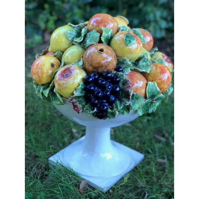 This wonderfully heavy glazed majolica fruit centerpiece is signed on the base . You can zoom in to see signature on one...