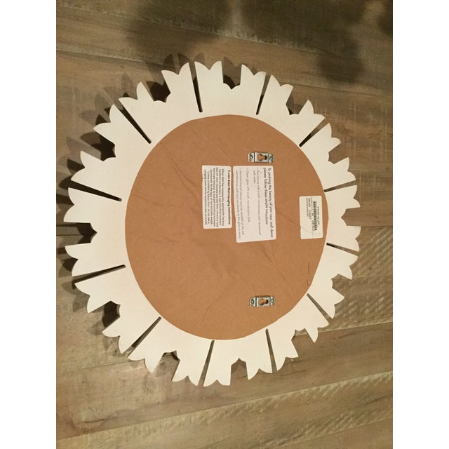 Lovely Sunburst Mirror is cast from an antique and finished in a high-gloss white to give it a modern appeal. Made of cast...