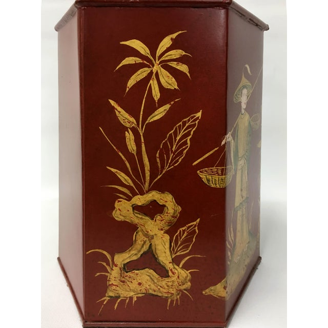 Hexagonal tole tea caddy lamp handpainted in gold with a Chinoiserie style featuring flowers and a Chinese figure...