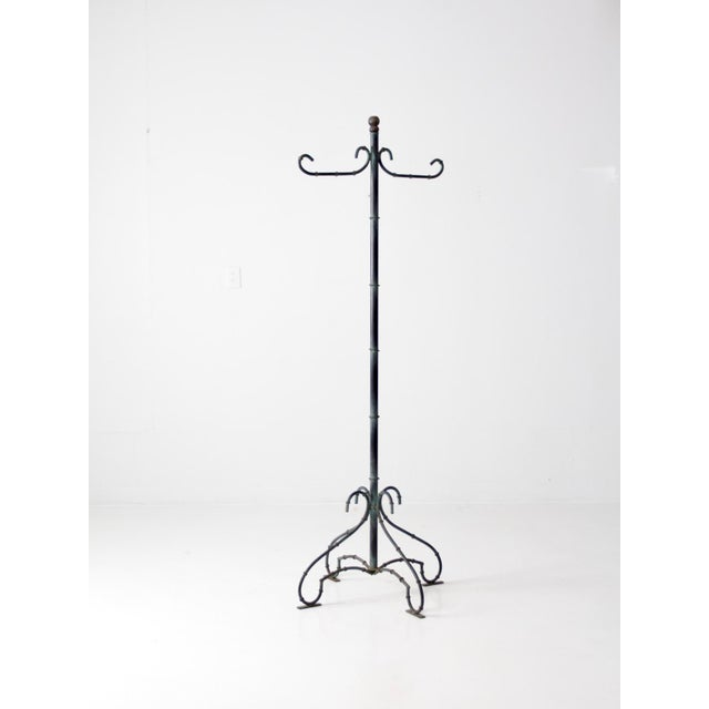 This is a vintage metal hall stand. The tall coat rack features linked rings creating the illusion of bamboo. Beautiful...
