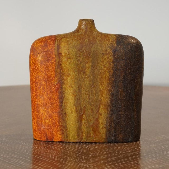 This listing is for a Marcello Fantoni wide shoulder vase with lava glaze. The coloring consists of burnt orange, raw...