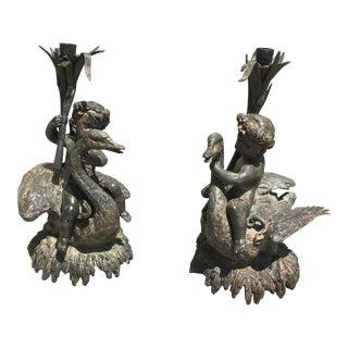 Vintage Patinated Bronze Cherubs Riding Swans Candlesticks - a Pair For Sale