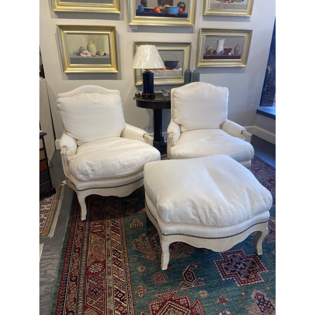 This is a beautiful pair of 1960s supersized bergere chairs. They have one matching ottoman. All cushions are down filled...