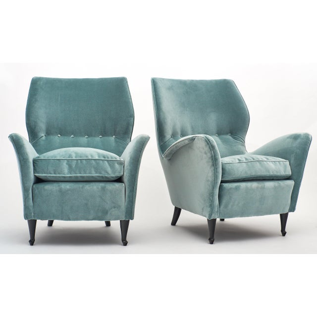 A pair of Carlo di Carli vintage velvet armchairs newly upholstered in a beautiful light gray-blue. We love the wooden...