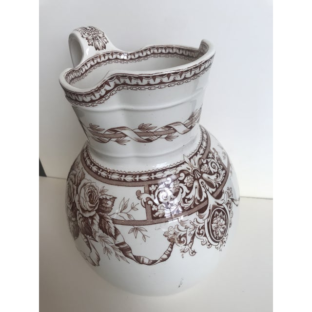 19th Century Large Scale Floral Ribbon English Ironstone Pitcher. Marked T. Furnival & Sons, Sharon.