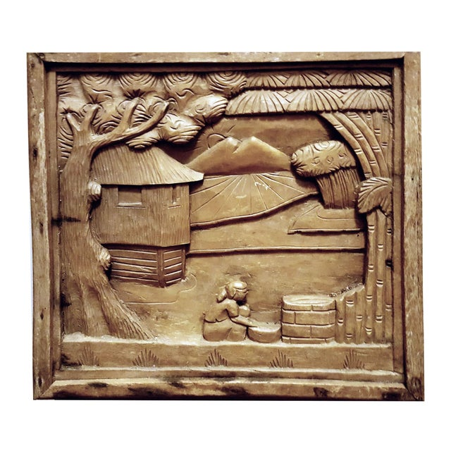 Two wooden hand carved wooden plaques that depict South Asian farm life. Although created as independent sculptures one as...