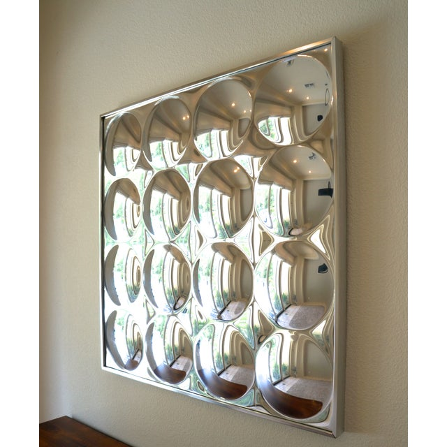 Super cool 1970s vintage op art wall mirror by Turner. 16 bubbles with aluminum frame.