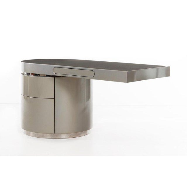 "J. WADE BEAM ""Ponte"" Desk Modernist cantilevered desk in matte metallic lacquer and chrome-clad steel with a central..."