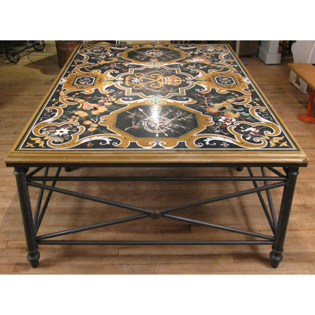 A gorgeous table with a Peitra Dura top, made entirely of cut and inlaid stone creating a beautiful and delicately...
