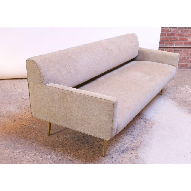 1950s Edward Wormley for Dunbar sofa on brass, tapered legs. The section under the backrest is recessed. Recently restored...