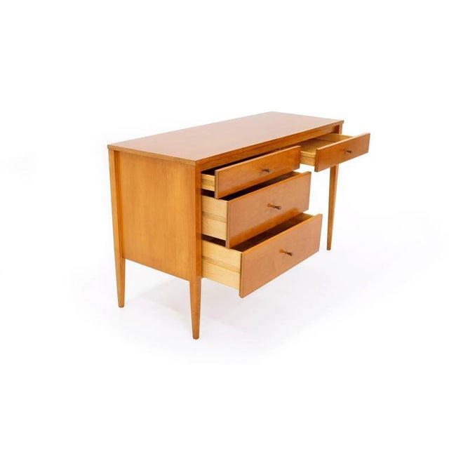 Excellent smaller scale Paul McCobb desk with the original pulls and in excellent condition.