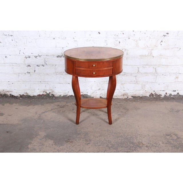 French Regency mahogany and brass side table Made by Baker Furniture Company USA, Late 20th century Cabriole legs + brass...