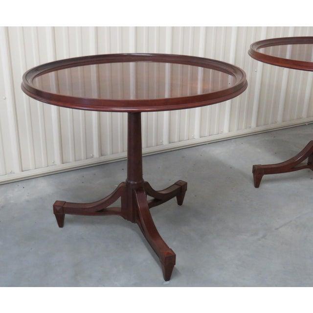 Pair of Baker Furniture mahogany center tables.