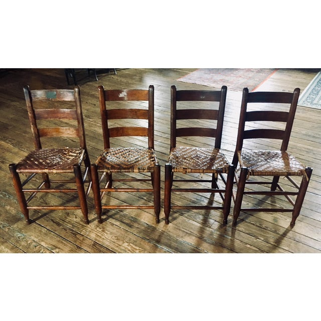 This set of four ladder-back rustic woven seat chairs caught my eye with their charming clothespin legs, turned and triple...