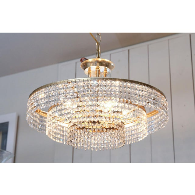 Bakalowits three-tier flush mount light: strings of cut-crystal prisms suspended from polished gilt-brass three tier...