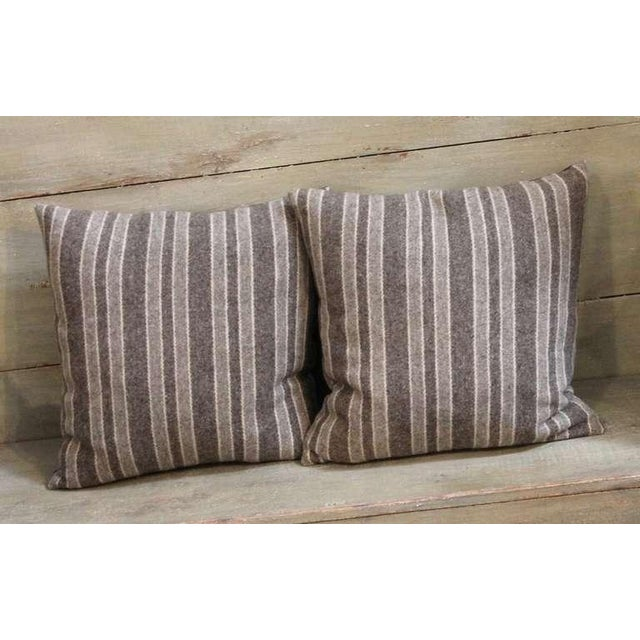 This traditionally classic pair of striped wool pillows is constructed from heavy late 19th century fabric. The pillows...