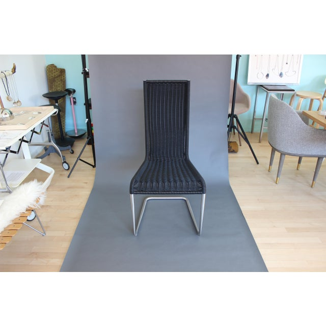 B20 Cantilever chair in black synthetic wickerwork and chrome base. Designed by TECTA in 1981. This chair based on a...