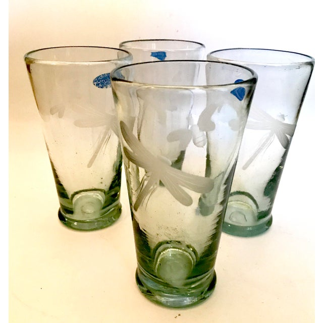 This is a rare set of never used and highly desirable 4 Mariposa highball glasses with both etched Dragonfly and...