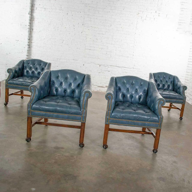 Fabulous blue vinyl faux leather Chinese Chippendale tub style game chairs on rolling casters set of four. In wonderful...
