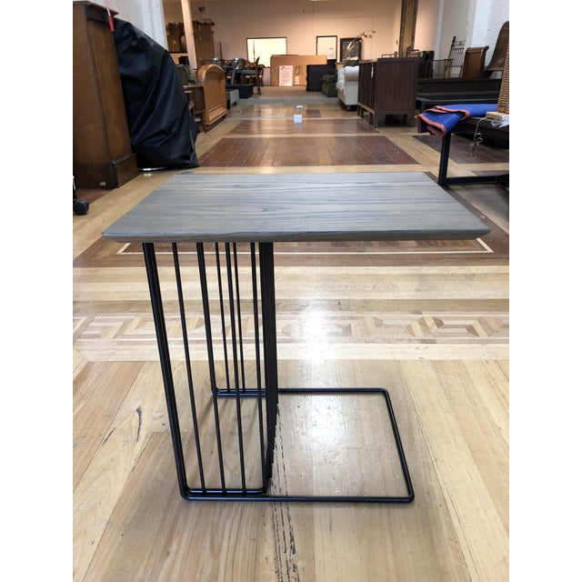 Design Plus Gallery presents the Anapo side table by Driade, designed by Gordon Guillaumier. A supported sculptural black...