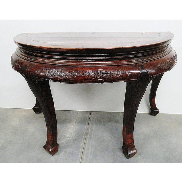 Antique demilune carved hall table.