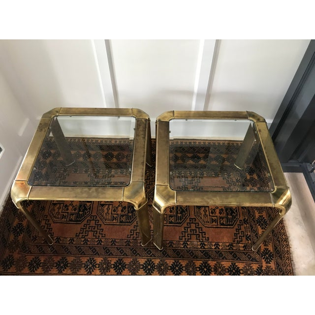 Very high quality tables made by John Widdicomb. Unlacquere brass waterfall frame with canted radius corners and legs....