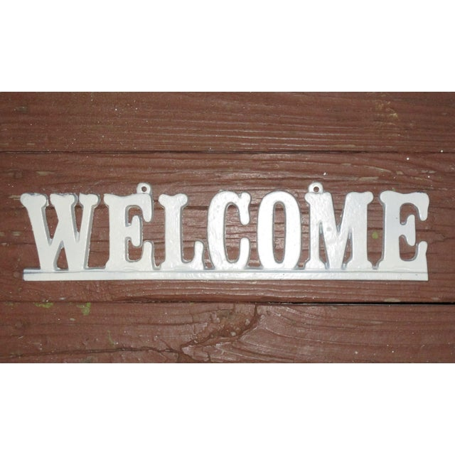 This vintage cast iron WELCOME sign is a great accent piece for your americana, farmhouse, or country cottage decor....