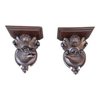 Pair of 19th Century German Black Forest Carved Walnut Wall Brackets For Sale