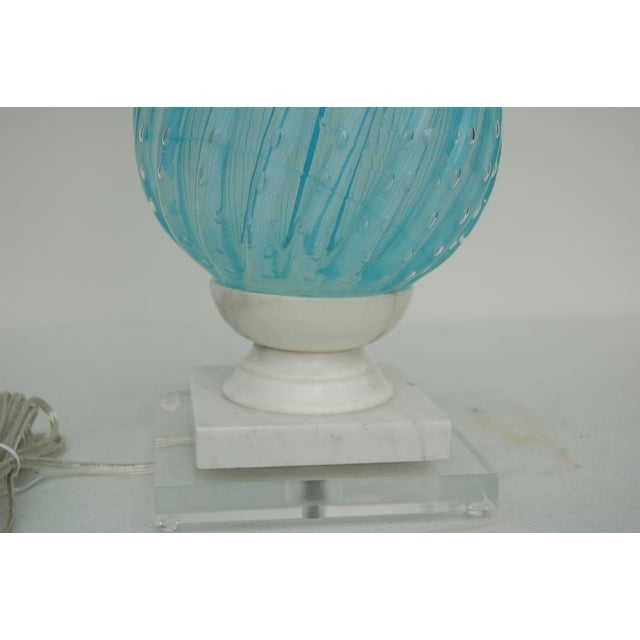 Stacked spheres of Venetian glass mounted on an Italian marble base. The SKY BLUE glass is filled with controlled bubbles...