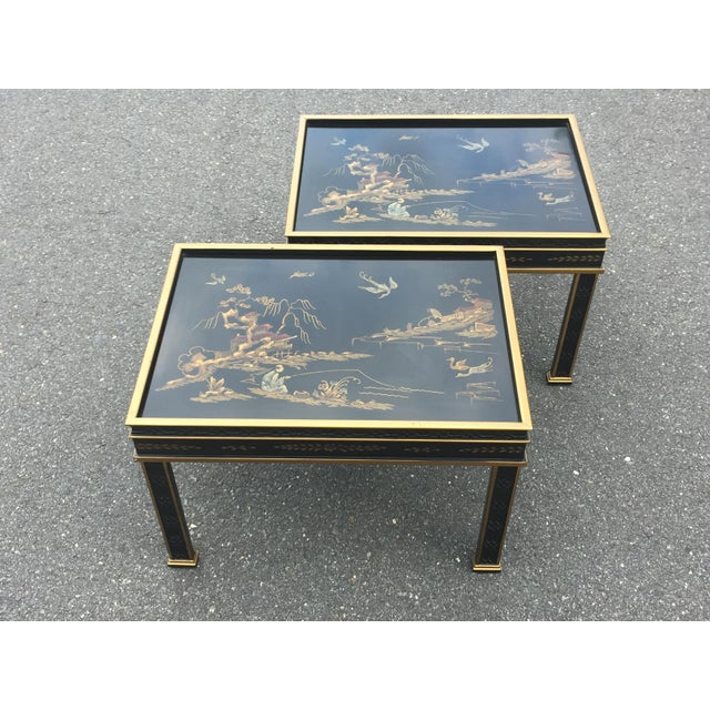 A beautiful pair of end tables by Drexel with gold outlining and Chinoiserie style decoration on recessed top surfaces....