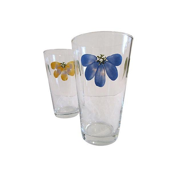 Vintage set of four clear glass Libbey pint tumblers featuring motif of blue and yellow flower petals. Perfect for serving...
