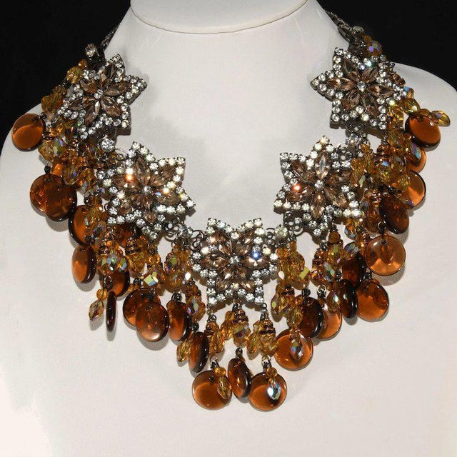 Amazing bib necklace with dangling elements including amber glass discs, amber crystal beads, light brown rhinestones,...