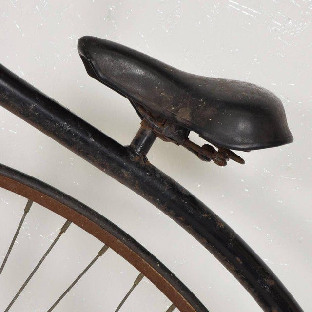 For your consideration an early Boneshaker high wheel bicycle. Original black paint showing signs of rust. Original label...